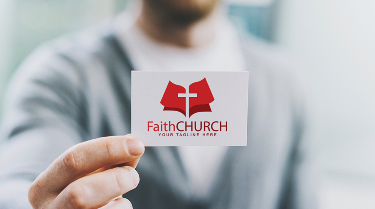 Picture of man holding Faith Church logo business card