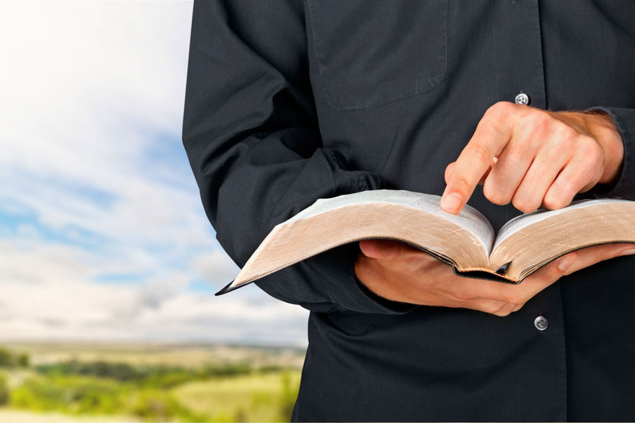 picture of man holding bible - for ultimate guide to redesigning a church website