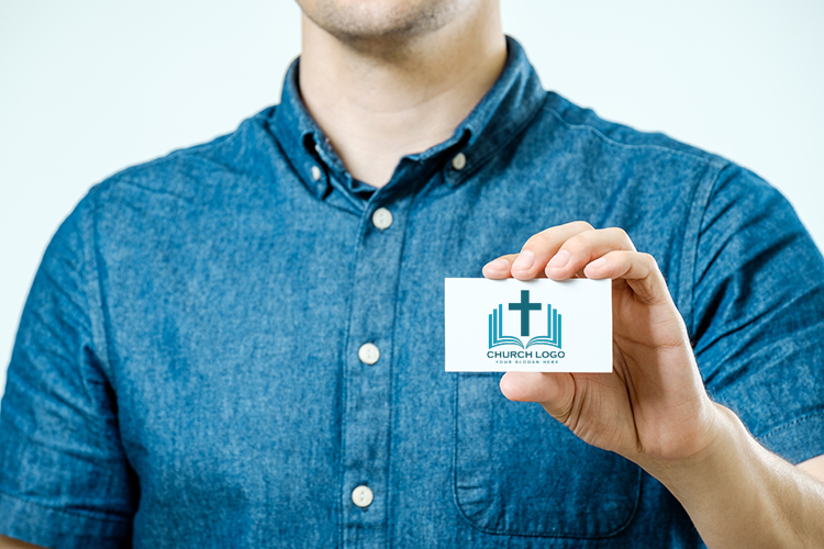 Man holding picture of church logo business card