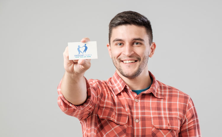 Picture of man holding Friendship Church business card